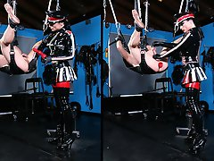 A subject is fixed to a love swing in her fully equipped SM studio, with his arse is fully exposed to his latex-clad Mistress.
