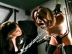Mistress clasps slave's nipples with pins