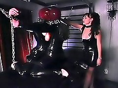 Mistress punishes two female slaves in latex