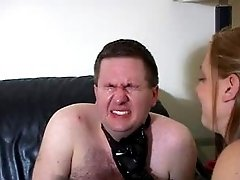 Mistress punishes slave through latex face slapping