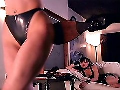 Mistresses spanking and whipping a naked woman